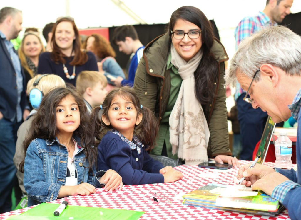 Axel Scheffler with children signing book