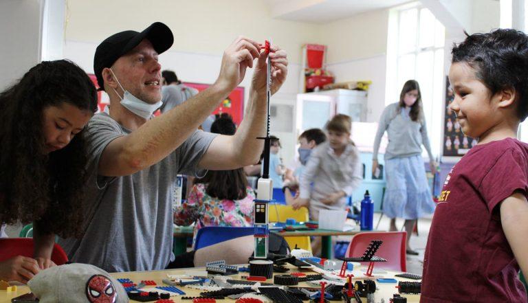 family enjoying lego workshop
