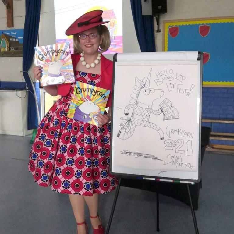sarah mcintrye with drawings at barnes festival